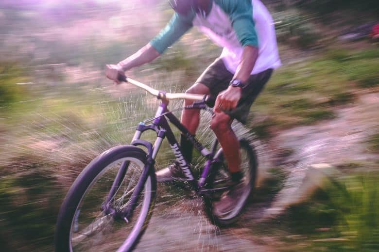 Man riding a hardtail mountain bike in the forest