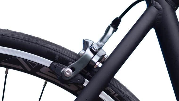 Black bike with rim brake