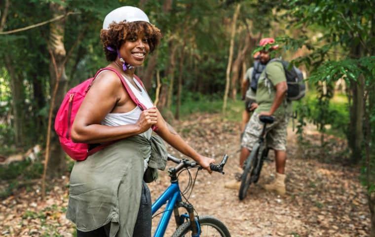 Happu woman on biking trip with friends