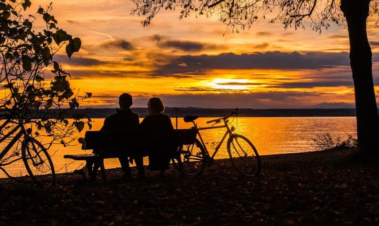 Two persons looking at sunset