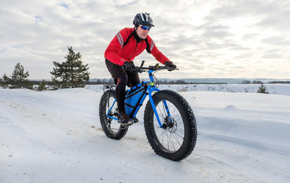 Man riding Fat tire bike in the snow
