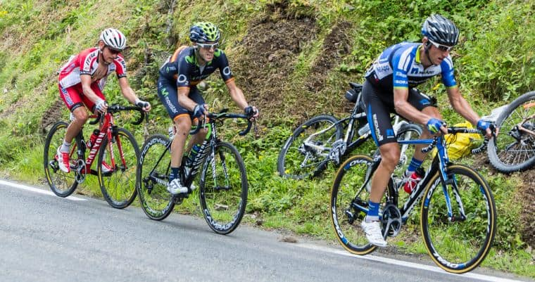 Professional cyclists climbing in a mountain stage