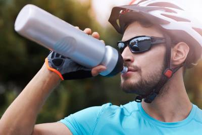 A cyclist drinking from a water bottle