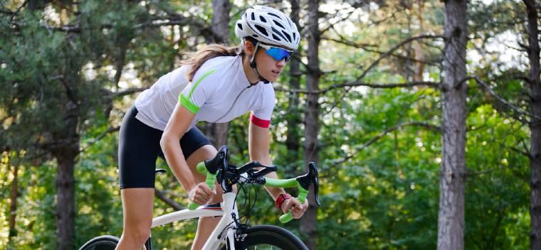 Women Riding A Road Bike