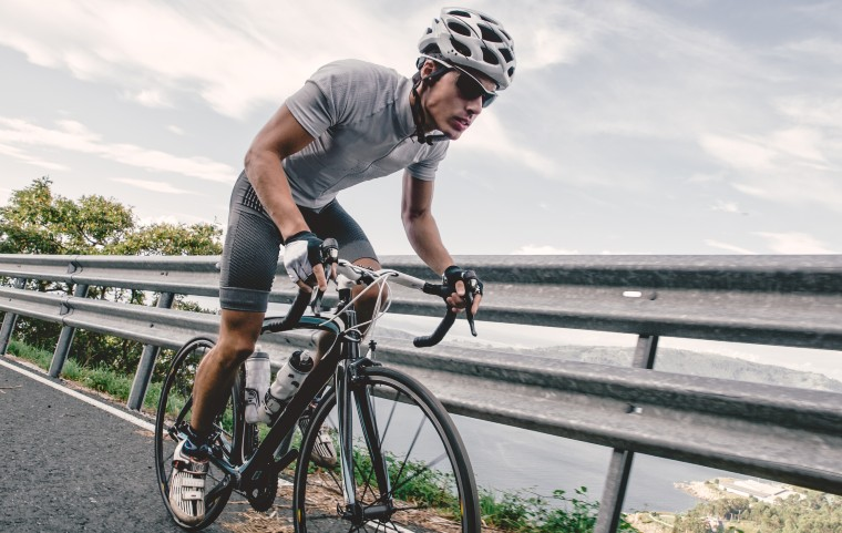 Cyclist On A Budget Road Bike